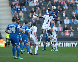 Milton Keynes Dons' Sanmi Odelusi (27) and Peterborough United's Michael Bostwick (6) go for the ball  - Photo mandatory by-line: Nigel Pitts-Drake/JMP - Tel: Mobile: 07966 386802 15/03/2014 - SPORT - FOOTBALL -  Stadium MK - Milton Keynes - Milton Keynes Dons v Peterborough United - Sky Bet League One