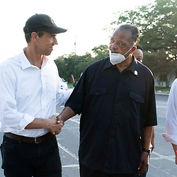 BETO O'ROURKE, l, shakes hands with legendary JESSE JACKSON as voting rights  groups march toward the Texas Capitol from north Austin on the third day of a 30-mile journey protesting Republican efforts to suppress votes nationwide and in Texas. Shifts of marchers trade off in an effort to combat oppressive Texas heat.  At right is Austin Mayor STEVE ADLER.