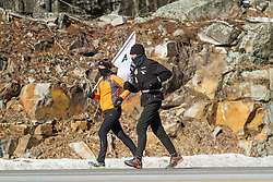 Sandra Freeman paces on Route 1 near York as Gary Allen runs 500 miles from Maine to the Super Bowl raising money for Wounded Warriors