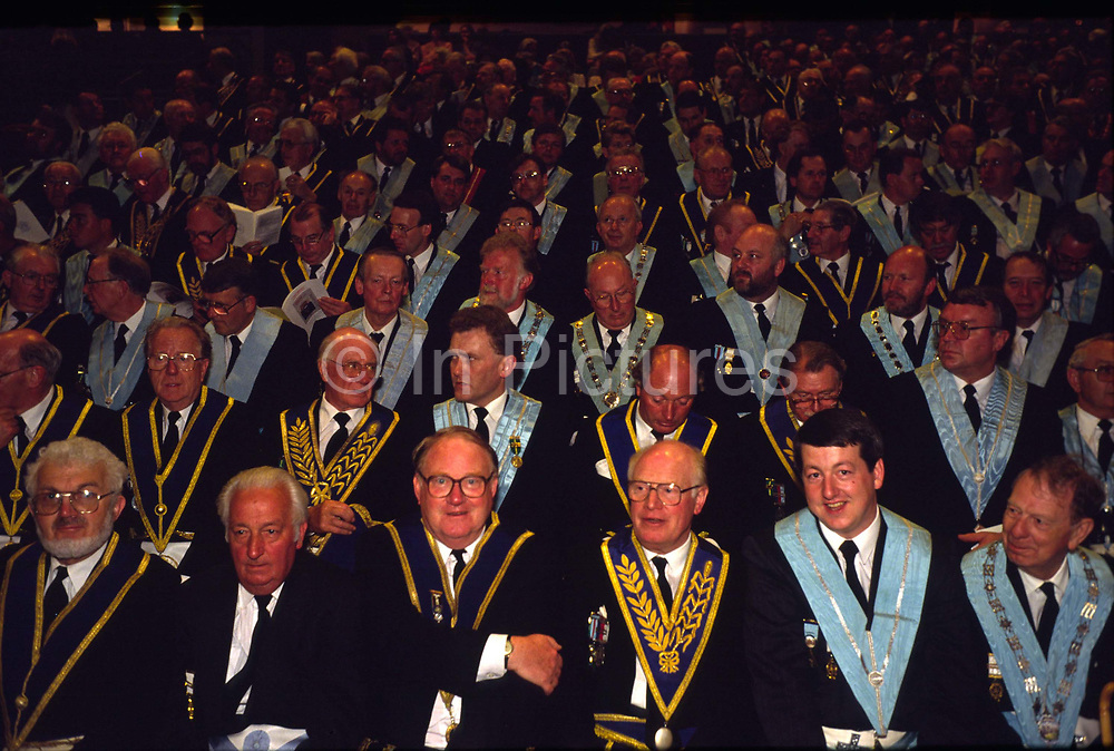 Assembled Freemasons watch a masonic ceremony at Earls Court, London..Freemasonry, which traces it's modern origins back to the sixteenth century is beased on principles of fraternity and secrecy. Members are sworn to keep silent on their activities and make themselves known to other Freemason's by way of signal (often a handshake).