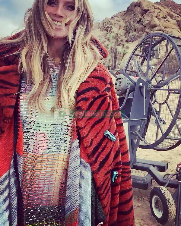 """Heidi Klum releases a photo on Instagram with the following caption: """"Shooting in the desert today ..... \ud83d\udc9a\ud83d\udc9c\u2764\ufe0f\ud83e\udde1 .......ready for the weekend \ud83d\ude1b #TGIF  #MISSONI @MISSONI"""". Photo Credit: Instagram *** No USA Distribution *** For Editorial Use Only *** Not to be Published in Books or Photo Books ***  Please note: Fees charged by the agency are for the agency's services only, and do not, nor are they intended to, convey to the user any ownership of Copyright or License in the material. The agency does not claim any ownership including but not limited to Copyright or License in the attached material. By publishing this material you expressly agree to indemnify and to hold the agency and its directors, shareholders and employees harmless from any loss, claims, damages, demands, expenses (including legal fees), or any causes of action or allegation against the agency arising out of or connected in any way with publication of the material."""