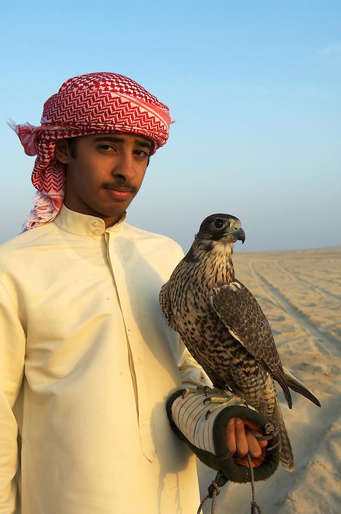 Emirati boy with his hawk, Abu Dhabi