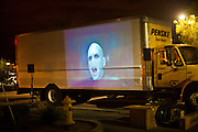 "24 NOVEMBER 2011 - PHOENIX, AZ: A Harry Potter movie is shown on the side of a rented truck at the Best Buy store on Thunderbird and I 17 in Phoenix. ""Black Friday,"" the unofficial start of the holiday shopping season started even earlier than normal. Many stores, including Target and Best Buy, opened at midnight. The Best Buy at Thunderbird and I 17 showed a Harry Potter movie on the side of a rented truck in the parking lot to keep people amused while they waited for the store to open.   Photo by Jack Kurtz"