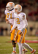 Nov 12, 2011; Fayetteville, AR, USA;  Tennessee Volunteers quarterback Matt Simms (12) runs off the field with offensive linemen Dallas Thomas (71) during a game against the Arkansas Razorbacks at Donald W. Reynolds Razorback Stadium. Arkansas defeated Tennessee 49-7. Mandatory Credit: Beth Hall-US PRESSWIRE
