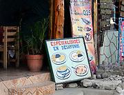 Sign outside a restaurant offering breakfast specialities, Especialadades en Desayunos. Panajachel, Republic of Guatemala. 04Mar14.