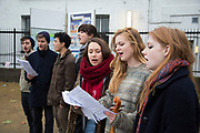 Young student Christmas carol singers performing / busking on the Southbank. The South Bank is a significant arts and entertainment district, and home to an endless list of activities for Londoners, visitors and tourists alike.