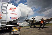 Supermarine Spitfire awaits refuelling with Avgas 100LL fuel (for piston engines) at Farnborough International Airshow launch