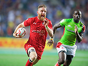Canada player Luke McCloskey runs past a Kenyan player to score a try  during Canada v Kenya match in the Cathay Pacific/HSBC Hong Kong 7s at Hong Kong Stadium, Hong Kong, Hong Kong on 7 April 2017. Photo by Ian  Muir.*** during *** v *** in the Cathay Pacific/HSBC Hong Kong 7s at Hong Kong Stadium, Hong Kong, Hong Kong on 7 April 2017. Photo by Ian  Muir.