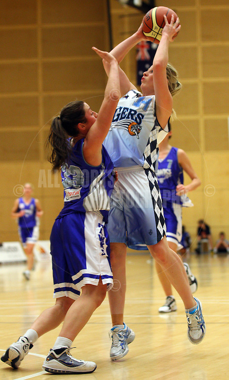 PERTH, AUSTRALIA - JULY 16: Melissa Marsh of the Tigers shoots over Gabby Clayton of the Hawks during the week 18 SBL game between the Perry Lakes Hawks and the Willetton TIgers at The State Basketball Center on July 16, 2011 in Perth, Australia.  (Photo by Paul Kane/All Sports Photography)