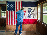 21 MAY 2019 - TIPTON, IOWA: A worker steams wrinkles out of an American flag before a Beto O'Rourke campaign appearance in Tipton, Tuesday. O'Rourke, running to be the 2020 Democratic nominee for the US Presidency, has made climate change a central part of his campaign. He held a town hall in Tipton Tuesday. Iowa traditionally hosts the the first election event of the presidential election cycle. The Iowa Caucuses will be on Feb. 3, 2020.                  PHOTO BY JACK KURTZ