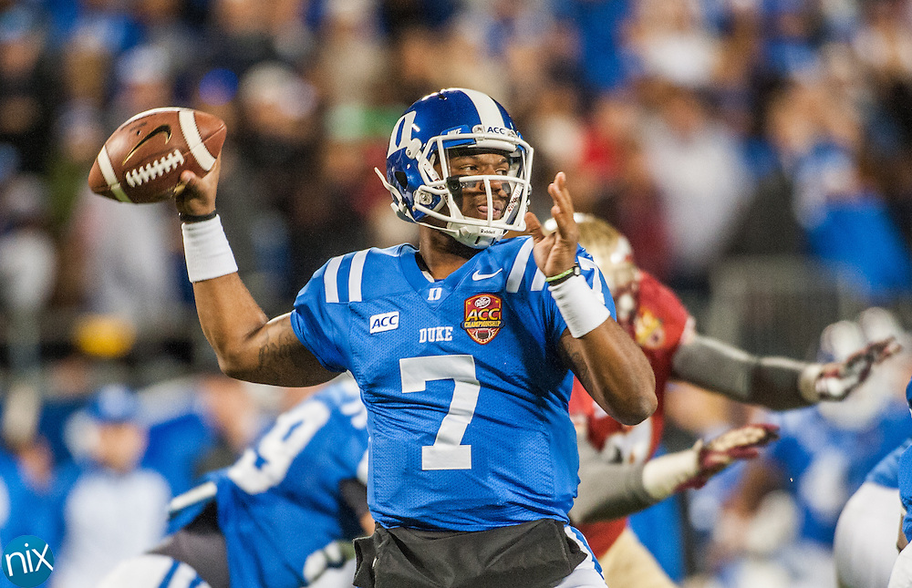 Duke's Anthony Boone passes the ball against Florida State during the ACC Championship game at Bank of America Stadium in Charlotte Saturday night. Florida State won the game 45-7.