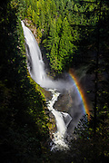 "A bright rainbow forms in the mist of Wallace Falls, a 367-foot (112 meter) waterfall that is the tallest of three falls in Wallace Falls State Park near Gold Bar, Washington. Wallace Falls was named for Joe and Sarah Kwayaylsh, members of the Skykomish tribe, who were the first homesteaders in the area; ""Wallace"" is a mispronounciation of their name."