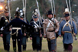 07 Jan,2006. New Orleans, Louisiana. Post Katrina.<br /> Old world meets new. The Battle of New Orleans re-enactment at Packenham Oaks in Chalmette near New Orleans, Louisiana. Period costumed British and American men along with 'irregulars' from the Independence/Civil War period commemorated the battle of Jan 8th, 1815 - the last battle of the war of 1812. The British led by General Edward Packenham were soundly defeated by troops hastily assembled by General Andrew Jackson. <br /> Photo; Charlie Varley/varleypix.com