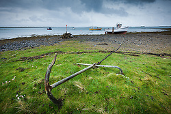 Boats and anchor at low tide in Clew Bay, County Mayo Ireland