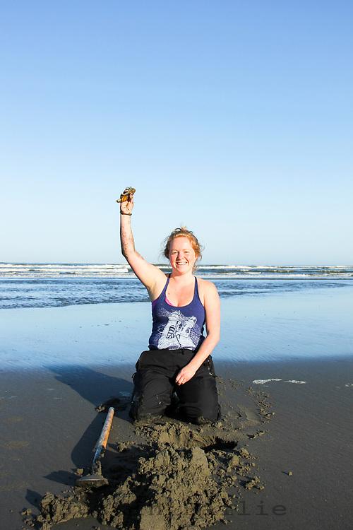 Digging razor clams in Seaside, Oregon.