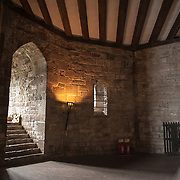A well-preserved room that formed part of the royal residence at Caernarfon Castle in northwest Wales. A castle originally stood on the site dating back to the late 11th century, but in the late 13th century King Edward I commissioned a new structure that stands to this day. It has distinctive towers and is one of the best preserved of the series of castles Edward I commissioned.