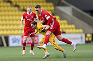 Aberdeen's Florian Kamberi (22) and Scott Pittman (8) of Livingston battles for possession, tussles, tackles, challenges, during the Scottish Premiership match between Livingston and Aberdeen at Tony Macaroni Arena, Livingstone, Scotland on 1 May 2021.