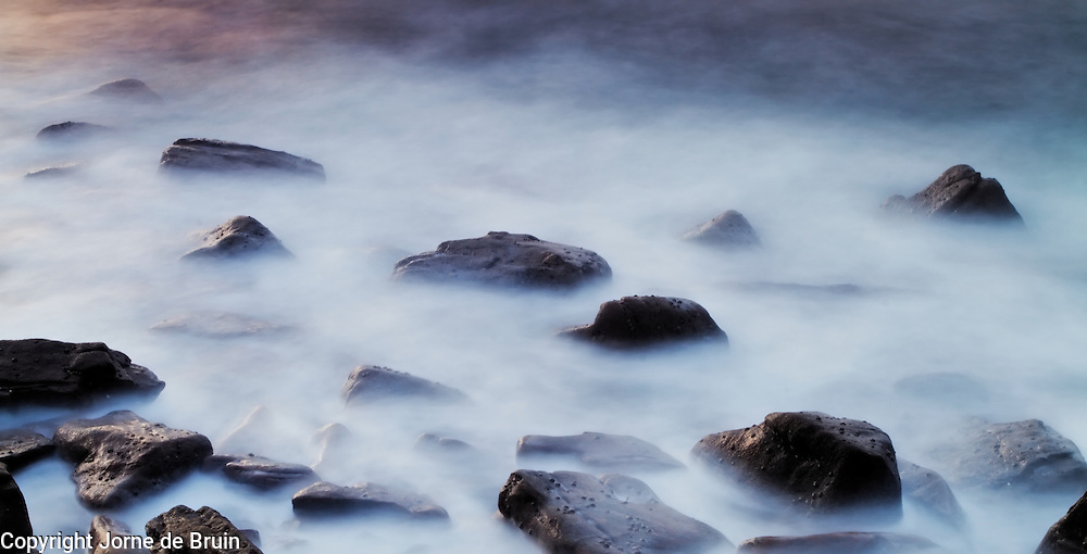 Rocks in the tide in the harbor of Elgol at sunset, Isle of Skye.