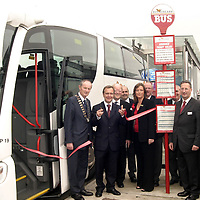 Minister for  Transport cuts the tape to officialy launch the new Bus Eireann Shannon Expressway.<br /> Also in pic . Pat Keane Mayor Of Clare. Dr  John Lynch Chairman C I E . Miriam Flynn AreaManager Bus Eireann Limerick, and Tim Hayer Acting Chief Ex.  Bus Eireann