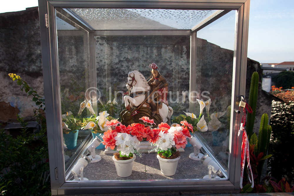Along with England, Saint George or Sao Jorge as he is called locally, is also the patron Saint of Rio de Janeiro, seen here a small figureine of him outside a house in Gamboa.