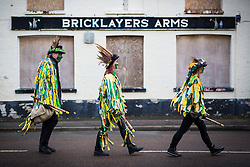 DATE CORRECTION. IMAGES SHOT 14/01/2017 © Licensed to London News Pictures. 14/01/2017. Whittlesey UK. Picture shows members of the Bourne Borderers Molly dancers at the 38th Whittlesey Straw Bear Festival this weekend. In times past when starvation bit deep the ploughmen of the area where drawn to towns like Whittlesey, They knocked on doors begging for food & disguised their shame by blackening their faces with soot. In Whittlesey it was the custom on the Tuesday following Plough Monday to dress one of the confraternity of the plough in straw and call him a Straw Bear. The bear was then taken around town to entertain the folk who on the previous day had subscribed to the rustics, a spread of beer, tobacco & beef. The bear was made to dance in front of houses & gifts of money, beer & food was expected. Photo credit: Andrew McCaren/LNP