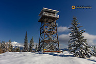 Firefighter Mountain Lookout Tower with Great Northern Mountain in the Flathead National Forest, Montana, USA