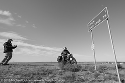"""Doug Jones stops with his 1929 Indian 101 Scout as he came into Limon, CO to have Dave Przygocki take a photo of him with the """"MCR Half way to Tacoma"""" sign during Stage 9 (249 miles) of the Motorcycle Cannonball Cross-Country Endurance Run, which on this day ran from Burlington to Golden, CO., USA. Sunday, September 14, 2014.  Photography ©2014 Michael Lichter."""