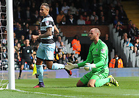 Football - 2016 /2017 Championship - Fulham vs Queens Park Rangers<br /> <br /> Fulham goalkeeper David Button on his knees after QPR first goal at Craven Cottage<br /> Tjaronn Chery 0f QPR follows the ball into the net.<br /> <br /> <br /> Credit : Colorsport / Andrew Cowie