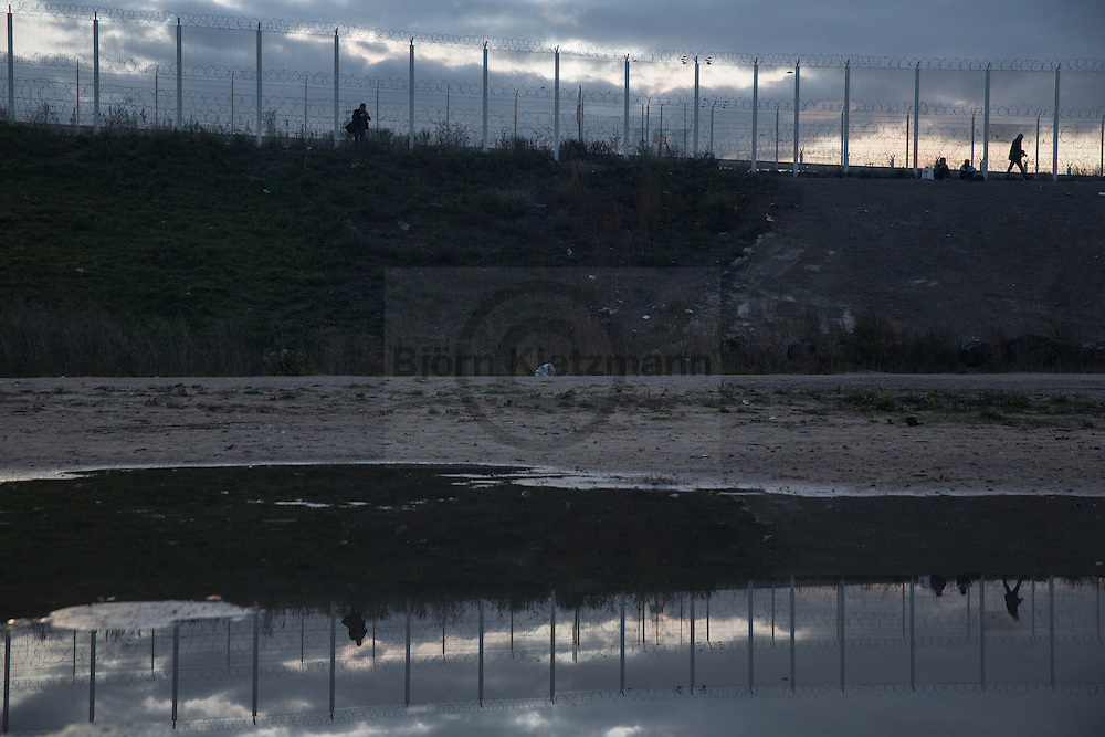 """Calais, Pas-de-Calais, France - 22.10.2016    <br />  <br /> So called """"Jungle"""" refugee camp on the outskirts of the French city of Calais on the weekend before the scheduled eviction. Many thousands of migrants and refugees are waiting in some cases for years in the port city in the hope of being able to cross the English Channel to Britain. French authorities announced that they will shortly evict the camp where currently up to up to 10,000 people live.<br /> <br /> Das sogenannte """"Jungle"""" Fluechtlingscamp am Rande der franzoesischen Stadt Calais, am Wochenende vor der angesetzten Raeumung. Viele tausend Migranten und Fluechtlinge harren teilweise seit Jahren in der Hafenstadt aus in der Hoffnung den Aermelkanal nach Großbritannien ueberqueren zu koennen. Die franzoesischen Behoerden kuendigten an, dass sie das Camp, indem derzeit bis zu bis zu 10.000 Menschen leben Kürze raeumen werden. <br /> <br /> Photo: Bjoern Kietzmann"""