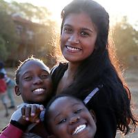 Watsonville, California high school student Saniya Lakka is all smiles as she volunteers at Botshabelo Children's AIDS Village in Magaliesburg, South Africa.<br /> Photo by Shmuel Thaler<br /> shmuel_thaler@yahoo.com<br /> www.shmuelthaler.com