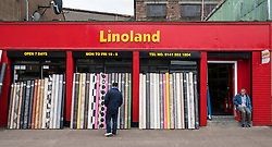 View of shop selling Linoleum flooring in Barras Market in Glasgow, Scotland, united Kingdom