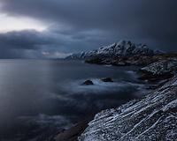 Dark sky over coast at noon during December Mørketid - Polar night, Nesland, Lofoten Islands, Norway