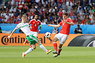 Ben Davies of Wales ® is challenged by Steven Davis of Northern Ireland.UEFA Euro 2016, last 16 , Wales v Northern Ireland at the Parc des Princes in Paris, France on Saturday 25th June 2016, pic by  Andrew Orchard, Andrew Orchard sports photography.