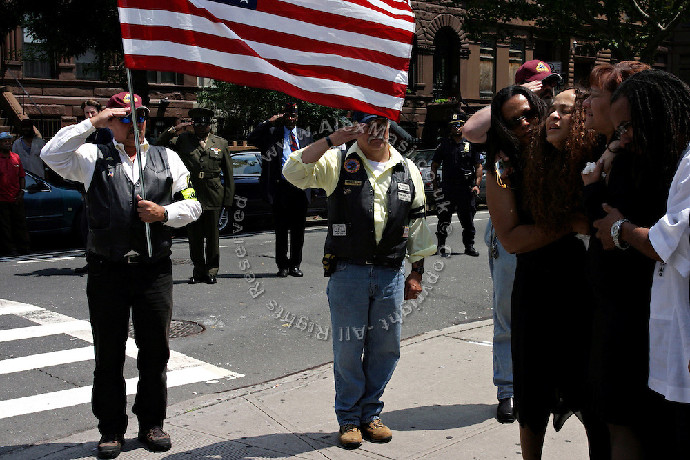 Members of the Patriot Guard Riders standing in front of the Bedsford Central Presbyterian church, while mourners from the family of LCpl. Nicholas J. Whyte are walking out after his funeral service, in Brooklyn, New York, NY., on Friday, June 30, 2006. LCpl. Nicholas J. Whyte, a 21-year-old American serviceman died  on June 21, 2006, while conducting combat operations in Al Anbar province, Iraq. The Patriot Guard Riders is a diverse amalgamation of riders from across the United States of America. Besides a passion for motorcycling, they all have in common an unwavering respect for those who risk their lives for the country's freedom and security. They are an American patriotic group, mainly but not only, composed by veterans from all over the United States. They work in unison, calling upon tens of different motorcycle groups, connected by an internet-based web where each of them can find out where and when a 'Mission' is called upon, and have the chance to take part. This way, the Patriot Guard Riders can cover the whole of the United States without having to ride from town to town but, by organising into different State Groups, each with its own State Captain, they are still able to maintain strictly firm guidelines, and to honour the same basic principles that moves the group from the its inception. The main aim of the Patriot Guard Riders is to attend the funeral services of fallen American servicemen, defined as 'Heroes' by the group,  as invited guests of the family. These so-called 'Missions' they undertake have two basic objectives in particular: to show their sincere respect for the US 'Fallen Heroes', their families, and their communities, and to shield the mourners from interruptions created by any group of protestors. Additionally the Patriot Guard Riders provide support to the veteran community and their families, in collaboration with the other veteran service organizations already working in the field.   **ITALY OUT**