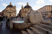 Rome Italy, Pedestrians walk on Piazza del Popolo, in front of the twin churches Santa Maria dei Miracoli, right  and Santa Maria di Montesanto, left.