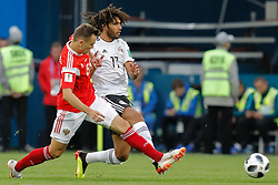 June 19, 2018 - Saint Petersburg, Russia - Denis Cheryshev (L) of Russia national team and Mohamed Elneny of Egypt national team vie for the ball during the 2018 FIFA World Cup Russia group A match between Russia and Egypt on June 19, 2018 at Saint Petersburg Stadium in Saint Petersburg, Russia. (Credit Image: © Mike Kireev/NurPhoto via ZUMA Press)