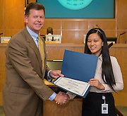 Trustee Harvin Moore poses for a photograph with Liana Wang during a meeting of the Board of Trustees, June 9, 2016.