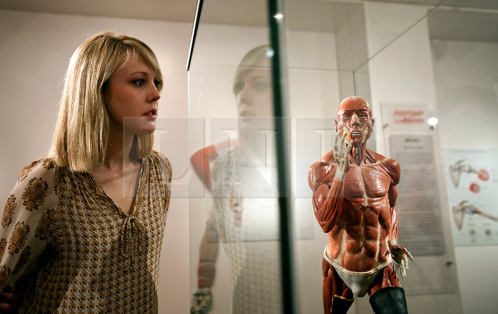 © Licensed to London News Pictures. 12/03/2012. London, UK. Denise Smith examines the model of sprinter Richard Whitehead, that she made in collaboration with Richard Neave. The model is anatomically correct and is designed to show the difference in physiology of an athlete that uses prosthetic limbs. Preview of the Royal College of Surgeons' 'Anatomy of an Athlete' exhibition. The exhibition opens on March 13 and looks at the latest innovations in orthopaedic surgery, prosthetics and training in creating and maintaining elite athletes. Photo credit : Spike Johnson/LNP