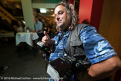 Photographer Horst Roesler at the Custom Chrome Europe evening party in the old town after a long day at the Intermot Motorcycle Trade Fair. Cologne, Germany. Friday October 7, 2016. Photography ©2016 Michael Lichter.