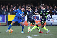 AFC Wimbledon attacker Harry Forrester (11) surrounded by 2 Bristol Rovers players during the EFL Sky Bet League 1 match between AFC Wimbledon and Bristol Rovers at the Cherry Red Records Stadium, Kingston, England on 17 February 2018. Picture by Matthew Redman.