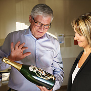 Séverine Frerson prepares to take over the role of cellar master from Hervé Deschamps at champagne Perrier-Jouët. Here, Deschamps shows her the intricate enamel and gold decorations on a bottle. Frerson will be the first woman at the helm in a row of seven male cellar masters before her. Founded in 1811 in Epernay, Maison Perrier-Jouët is one of France's most historic champagne houses, but also one of its most distinctive, renowned for its floral and intricate champagnes which reveal the true essence of the Chardonnay grape. Started in 1811, its cellars holds the world's two oldest known bottles of champagne, the 1825 vintage.