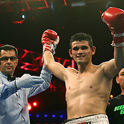 WINTER PARK, FL - AUGUST 02:  Jorge Cota of Sinaloa, Mexico celebrates his victory over Yudel Jhonson of Cuba, during the Premier Boxing Champions on Bounce TV boxing match at Full Sail University - Ebbs Auditorium on August 2, 2015 in Winter Park, Florida. Cota won the bout by unanimous decision. (Photo by Alex Menendez/Getty Images) *** Local Caption *** Yudel Jhonson; Jorge Cota