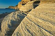 Limestone rcok along Cap Bon-Ami with Cap Gaspé in background<br />Forillon National Park<br />Quebec<br />Canada