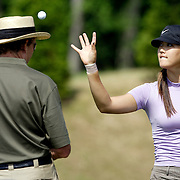 HAVRE DE GRACE, MD, June 5, 2007:  Michelle Wie practices under the watchful eye of coach David Leadbetter two days before the start of the LPGA Championship in Havre De Grace, MD on June 5, 2007.  (Photo by Todd Bigelow/Aurora)