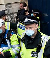 Police make arrests at the anti-lockdown protest  Trafalgar Square, London 24th oct 2020 photo by Brian Jordan