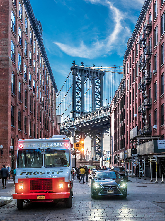 The Brooklyn Bridge is the bridge that spans from Manhattan Island to Brooklyn over the East River in New York City.