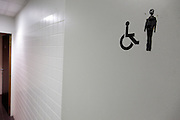 toilet door with male and handicap sign