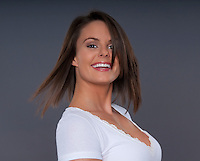 Portrait of attractive young woman brunette smiling.