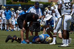 April 29, 2017 - Los Angeles, California, U.S. - UCLA Bruins head coach Jim Mora look on as Kenny Lacy (76) is treated after a injury during the UCLA football Spring Showcase on Saturday, April 29, 2017 in Los Angeles. (Photo by Keith Birmingham, Pasadena Star-News/SCNG) (Credit Image: © San Gabriel Valley Tribune via ZUMA Wire)