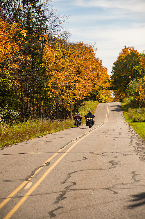 Fall color motorcycle touring on Michigan's Upper Peninsula near Marquette, Michigan.